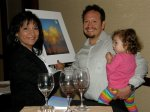 Chris Martinez giving one of his auctioned pieces of artwork to the winner of the auction.